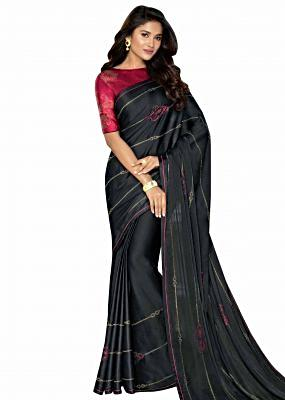 Black saree in satin with kundan work and red piping border