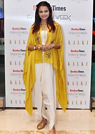 Off white dhoti pant and crop top paired with embroidered mustard kaftan