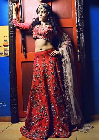 Rani pink lehenga matched with zardosi embroidery only on Kalki
