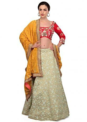Pista green and blood red lehenga choli with weaved dupatta only on Kalki