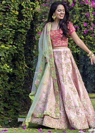 Baby pink lehenga in raw silk showcasing the resham zari work with fancy 3D flowers only on Kalki
