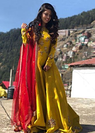 Charlie Chauhan in Kalki Mustard anarkali suit in raw silk beautified in resham and zari