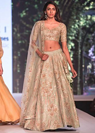 Mud green lehenga in raw silk embellished in gotta patch and zardosi work only on Kalki