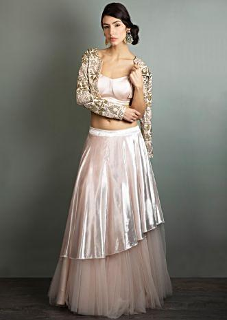 Powder pink net skirt with velvet top layer paired with a matching crop top and cut dana embroidered  jacket