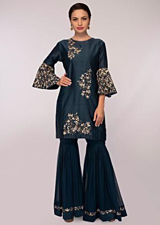 Admiral blue embroidered silk suit paired with georgette sharara and matching net dupatta