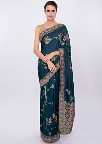 Admiral blue silk saree with floral weaved embroidery  only on Kalki