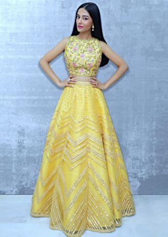 Yellow net lehenga set paired with a contrasting off white net dupatta