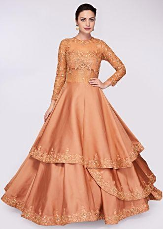 Apricot brown ballroom gown with multiple layers in net  and crepe