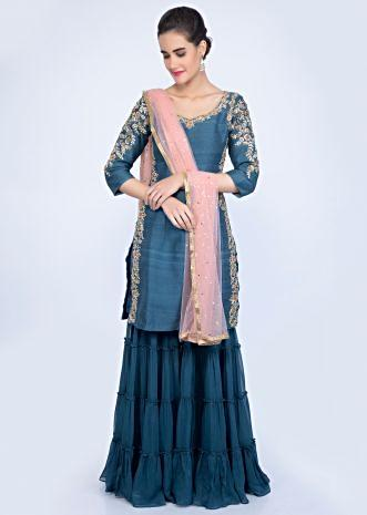 7f0293ad5344 Azure blue embroidered suit with crushed georgette sharara and peach net  dupatta only on kalki ...