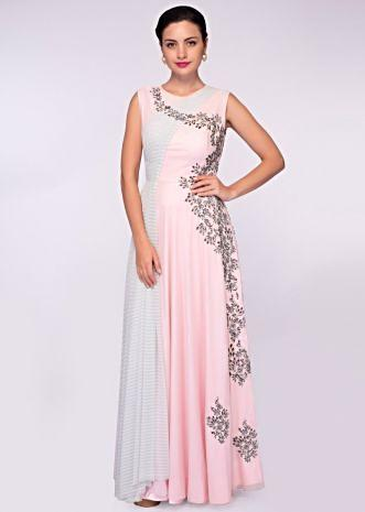 Baby pink lycra net gown with one side embroidery and one side drape