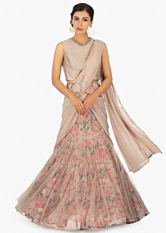 Beige embroidered blouse paired with a digital rose print lehenga in pre stitched pleated pallo