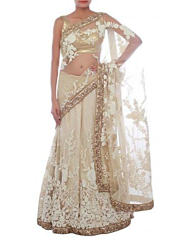 Glossy beige lehenga saree embellished in pearl and thread embroidery only on Kalki