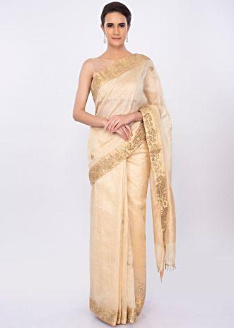 Beige linen saree with floral embroidered butti and border only on kalki