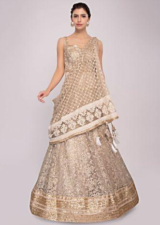 Beige net anarkali suit in zari and sequins chicken embroidery