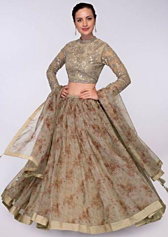 Beige organza floral printed lehenga and dupatta paired with embroidered net blouse  only on Kalki