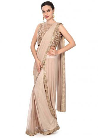Classic beige saree gown adorn in embroidered border only on Kalki
