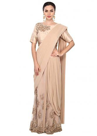 Beige saree gown adorn in pearl and sequin embroidery only on Kalki