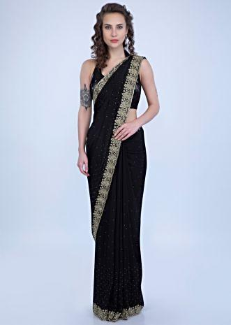 de488cede7f363 Black satin chiffon saree with heavy floral embroidered border only on Kalki