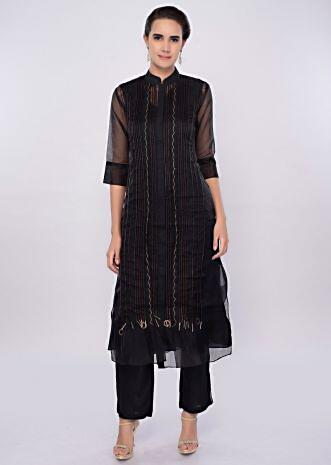 Black three piece suit designed with pleats only on Kalki