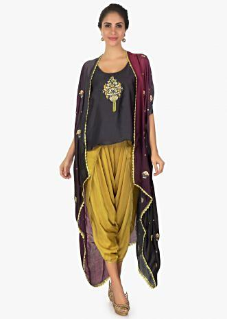 Black top paired with khaki overlapping dhoti pant and a overlay jacket