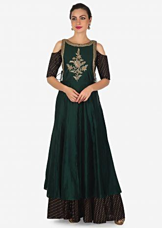 Black anarkali suit matched with dark green top layer adorn in cut dana and zardosi only on Kalki