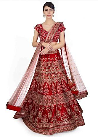 Blood red raw silk embroidered lehenga and blouse paired with powder pink net dupatta