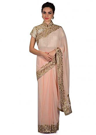 Blush peach saree in applique embroidery only on Kalki