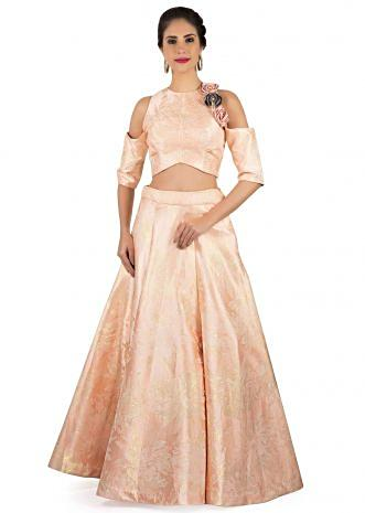 Blush peach lehenga in brocade matched with 3D flower embroidered crop top only on Kalki