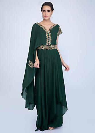 f211466ccd Bottle green embroidered jumpsuit with additional flared layer on one  shoulder only on Kalki ...