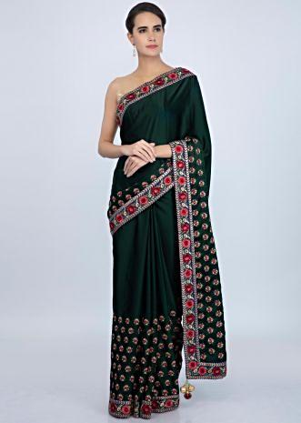 Bottle green satin saree in multi color resham embroidery and butti only on Kalki