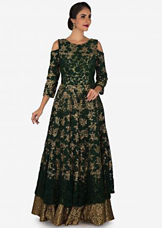 Bottle green anarkali gown featured in embroidered lace with sequin lining only on Kalki