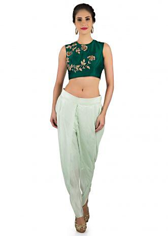 Bottle green zardosi embroidered crop top with cream dhoti pant only on Kalki