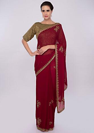 55cb138150181e Brick red embroidered georgette saree with contrasting golden palm blouse  only on Kalki