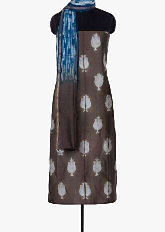 Brown cotton silk unstitched suit paired with blue cotton bottom and shaded dupatta