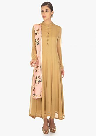 Brown georgette suit in kali paired with a contrasting lime green cotton silk floral printed dupatta