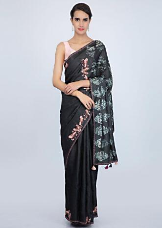 Charcoal grey tussar silk saree with batik printed pallo and bird patch work at the border only on Kalki