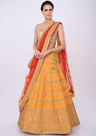 0d4bc065e0273 Chrome yellow raw silk lehenga with orange net dupatta only on kalki ...