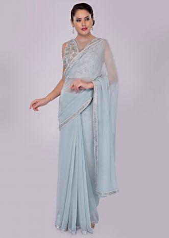 Cloud grey georgette saree with cord embroidered net blouse