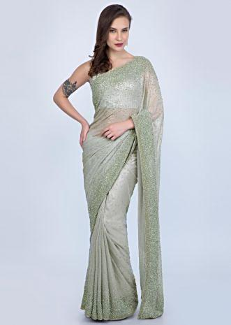 dc7a5c309519d Cloud grey shimmer georgette saree with heavy sequins embroidery only on  Kalki ...