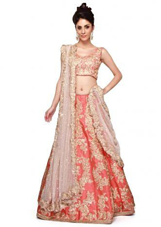 Coral lehenga featuring with gold zari embroidery only on Kalki