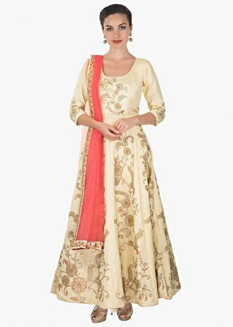 Cream anarkali in cotton silk paired with lycra chudidar and peach net dupatta only on kalki