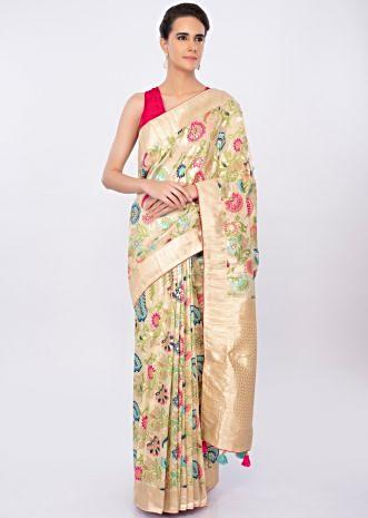 Cream beige brocade saree in multi color floral embroidery only on kalki