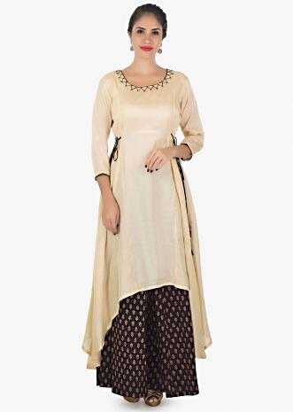 Cream cotton kurti matched with printed palazzo with tie ups thread work only on kalki.