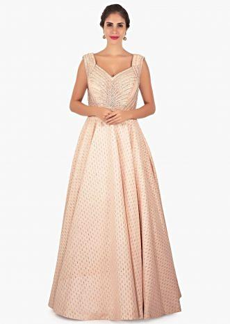 Cream fancy shimmer gown in sequins butti with deep v from back only on Kalki
