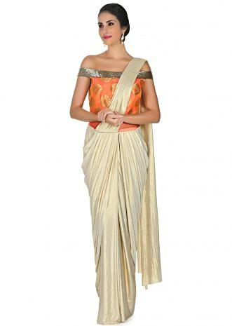 Cream foil saree gown with orange brocade bodice only on Kalki