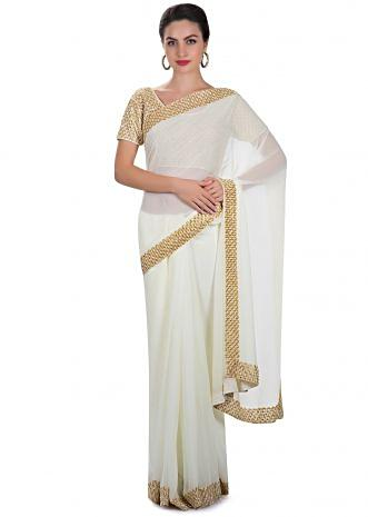 Cream georgette saree adorned with cut dana and thread workonly on Kalki