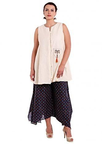 Cream top with fancy pocket matched with palazzo pant only on Kalki