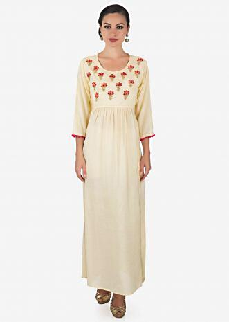 Cream dress adorn in embroidered butti and gathers only on Kalki
