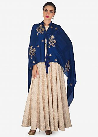Cream anarkali suit matched with royal blue embroidered fancy cape only on Kalki