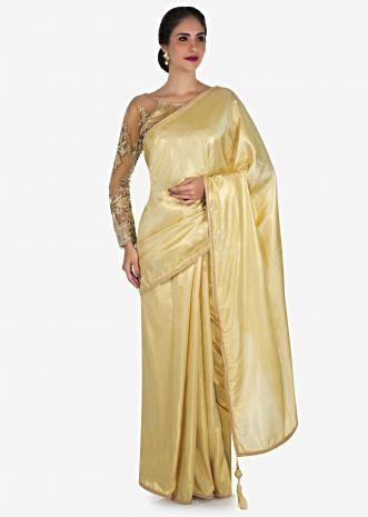 Cream saree in shimmer foil featuring the moti embroidered work only on Kalki